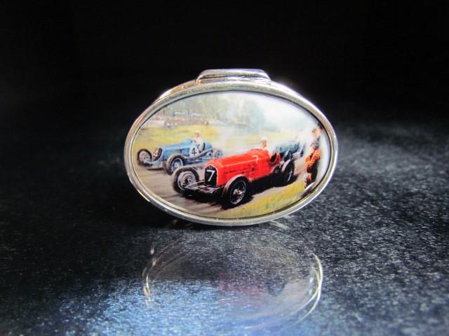 Lot 8 - Silver pill box with enamel set lid depicting a vintage car