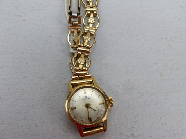 Lot 30 - 9ct Gold Hallmarked cased ladies watch by Hamilton on a Gold Coloured metal starp