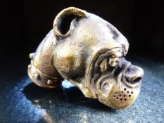 Brass cased vesta in the form of a dog