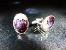 Pair of silver and enamel cufflinks set with a pictorial image of Winston Churchill