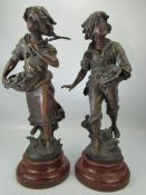 Pair of bronzed spelter figures signed L & J Moreau