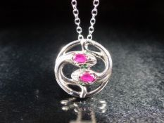 Silver and rubilite snake pendant necklace