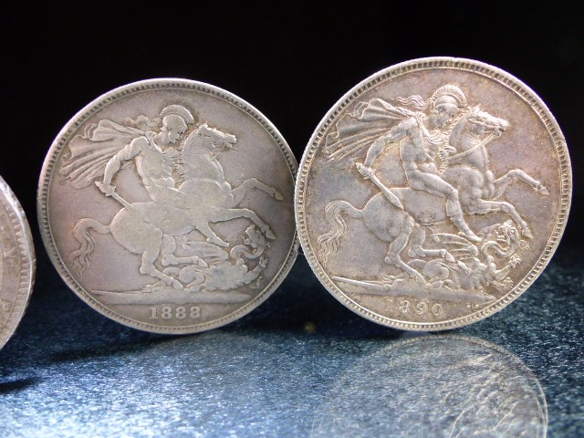 Lot 32 - A Silver George III crown, 1819 and Victoria crowns 1888 & 1890 and a George V 1920 half crown.