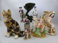 Collection of various ceramics to include Staffordshire man on zebra, cat with glass eyes and a
