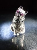 Silver cat pendant with ruby eyes and emerald collar