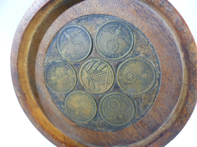 Lot 42 - Seven Nazi coins set into a small wooden tray