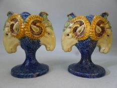 Pair of rams head majolica urns / spill vases on pedestal bases (possibly Minton or Staffordshire)