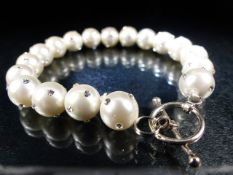 Large freshwater pearl bracelet inset with CZs on silver clasp