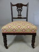 Newly re-upholstered Edwardian mahogany bedroom chair on castors