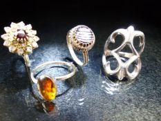 Collection of four rings one set with Amber