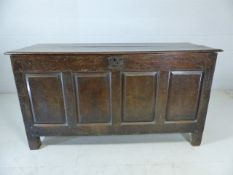 Large oak plank-topped coffer with four panels to front