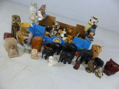 Large collection of ornaments, mostly owls and elephants