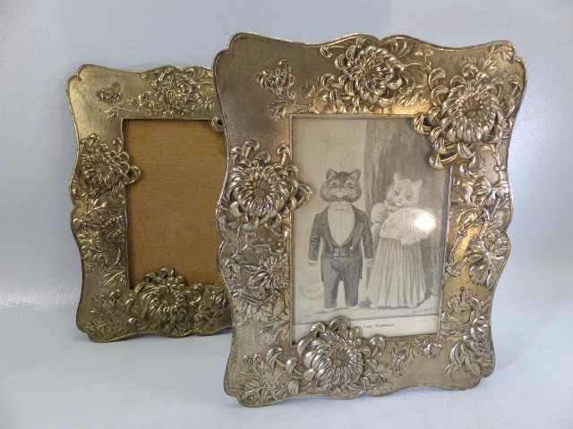 Lot 13 - Two Silver coloured ornate photo frames and one small hallmarked Silver photo frame
