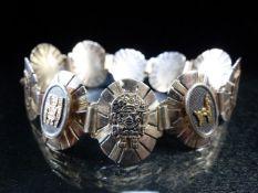 Silver 925 bracelet with sunburst panels with alternate gold & Silver coloured emblems
