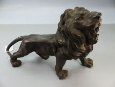 Cast metal figure of a roaring lion