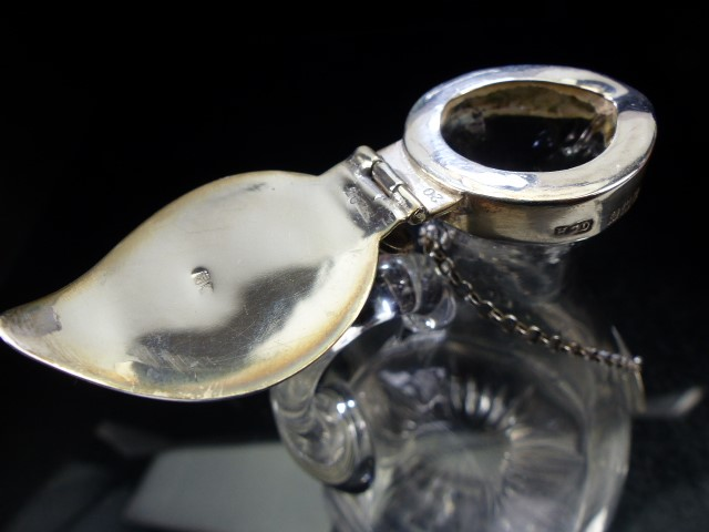 Lot 2 - Noggin Glass flask with Hallmarked Silver Lid and collar and a Hallmarked Silver Whiskey plaque on