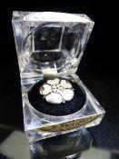Hallmarked Silver Brooch set with enamel white shamrocks