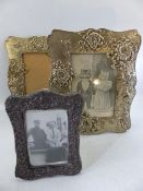 Two Silver coloured ornate photo frames and one small hallmarked Silver photo frame