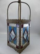 Brass lantern with four stained glass panels
