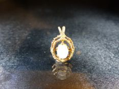 Hallmarked 9ct Gold Pendant set with an Opal