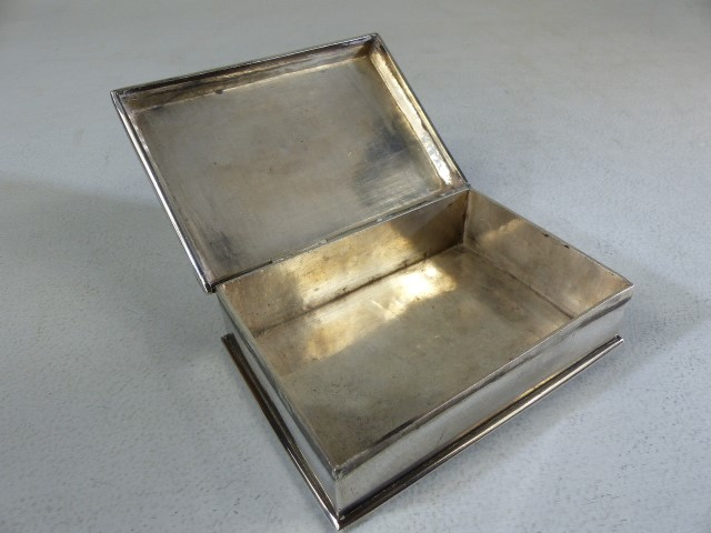 Lot 4 - Silver cigarette/ card box marked 800 to the reverse the lid surmounted with a skull and cross bones