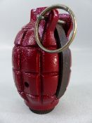 A WWII Mills No.36 hand grenade - demo/practice model with original pin