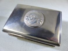 Silver cigarette/ card box marked 800 to the reverse the lid surmounted with a skull and cross bones