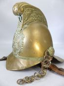 An early 20th century brass fireman's helmet. High comb design with dragon decoration and crossed