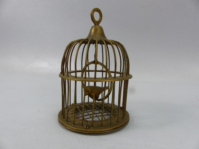 Lot 26 - Brass bird in a cage on swinging hoop