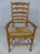 Rush-seated ladderback armchair