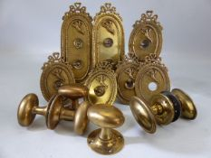 Collection of Victorian brass door furniture to include handles and single and double light