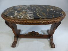 Heavily Carved occasional table with marble top supported by Angels