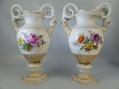 A pair of Meissen two-handled vases, with waisted necks and domed feet, with gilt borders and