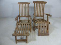 Pair of teak garden steamer chairs