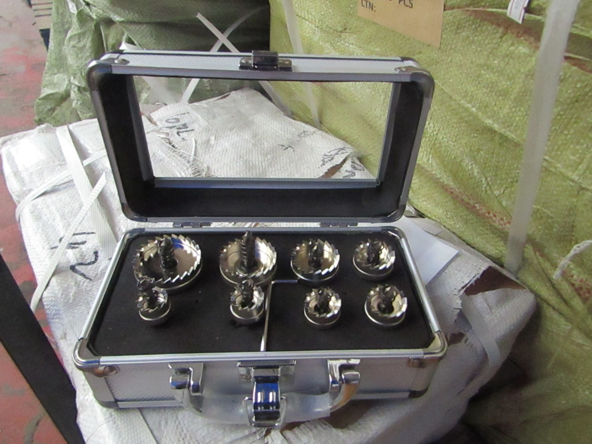 Lot 4 - 8 piece hole saw set in metal carry case, new