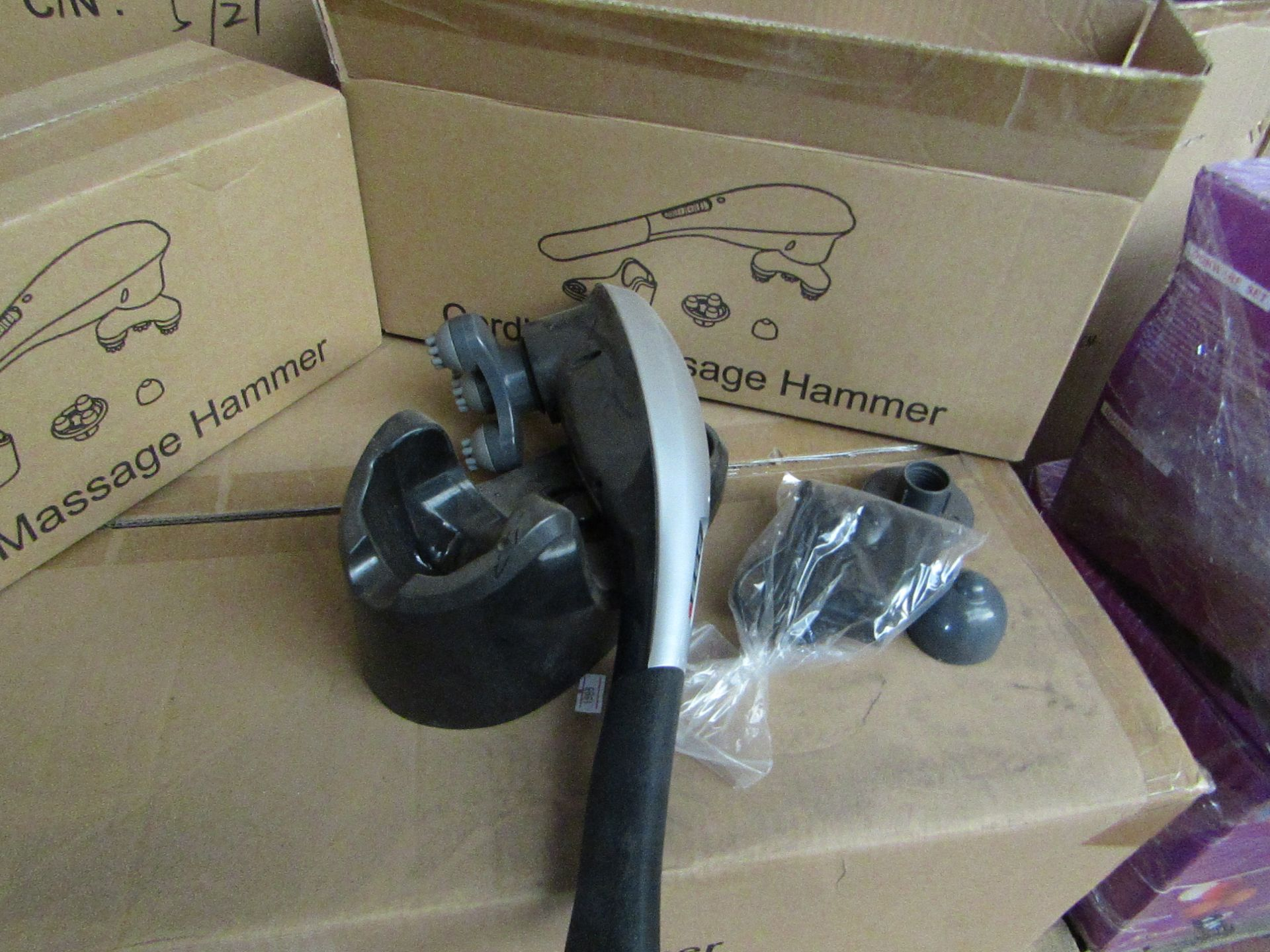Lot 216 - Cordless handheld massage hammer with various head attachments. New & boxed