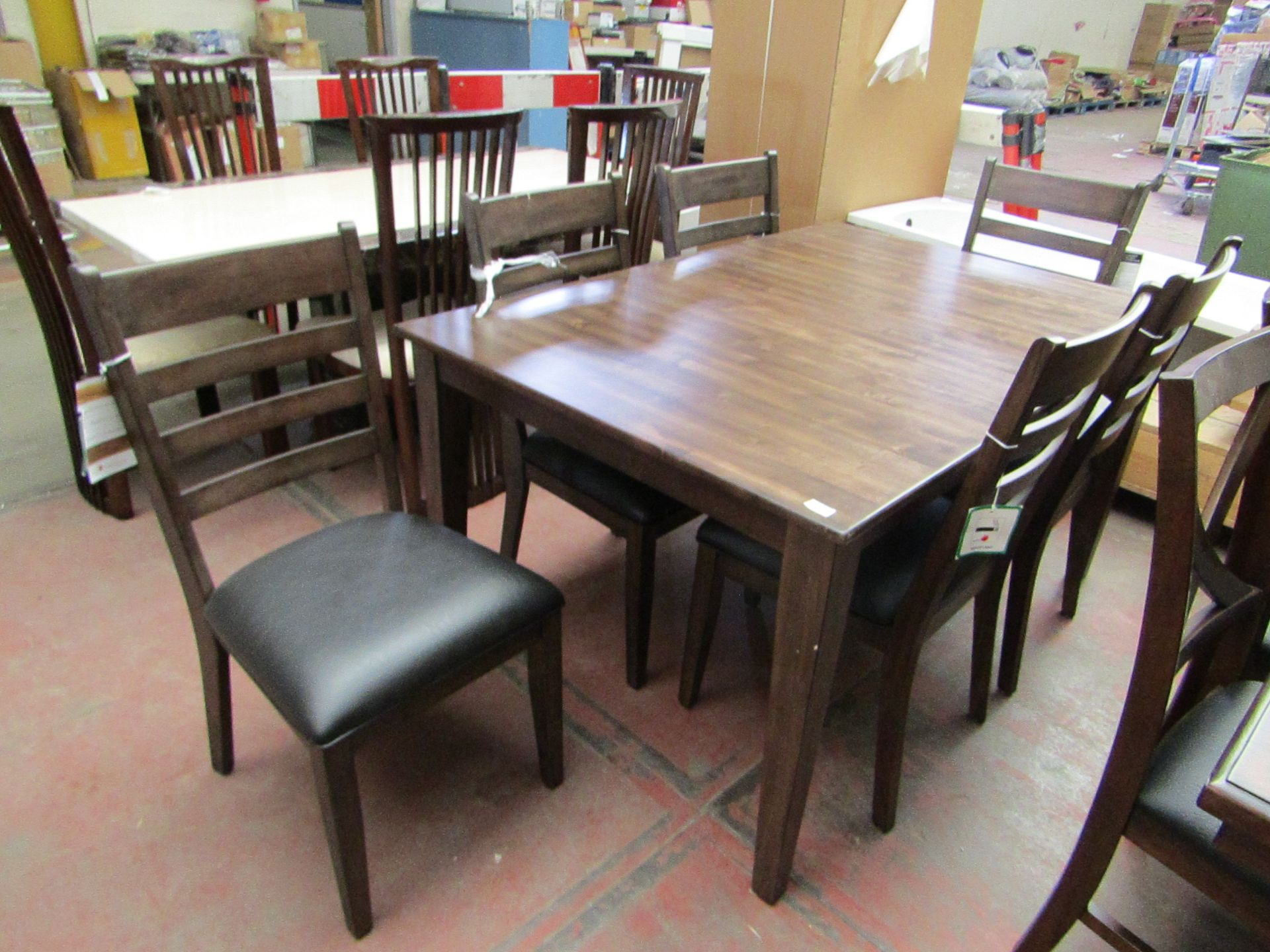 Lot 22 - Imagio Solid wood 7 piece extending dining set, few small marks on the table and chairs but