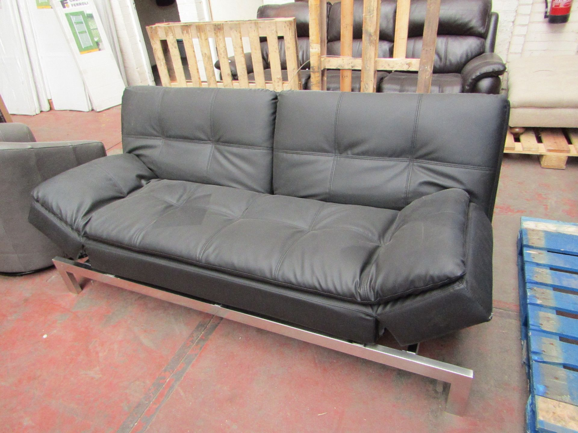 Lot 11 - Lifestyle solutions Sofa bed, the back folds down to form a double bed the just pulls back up to