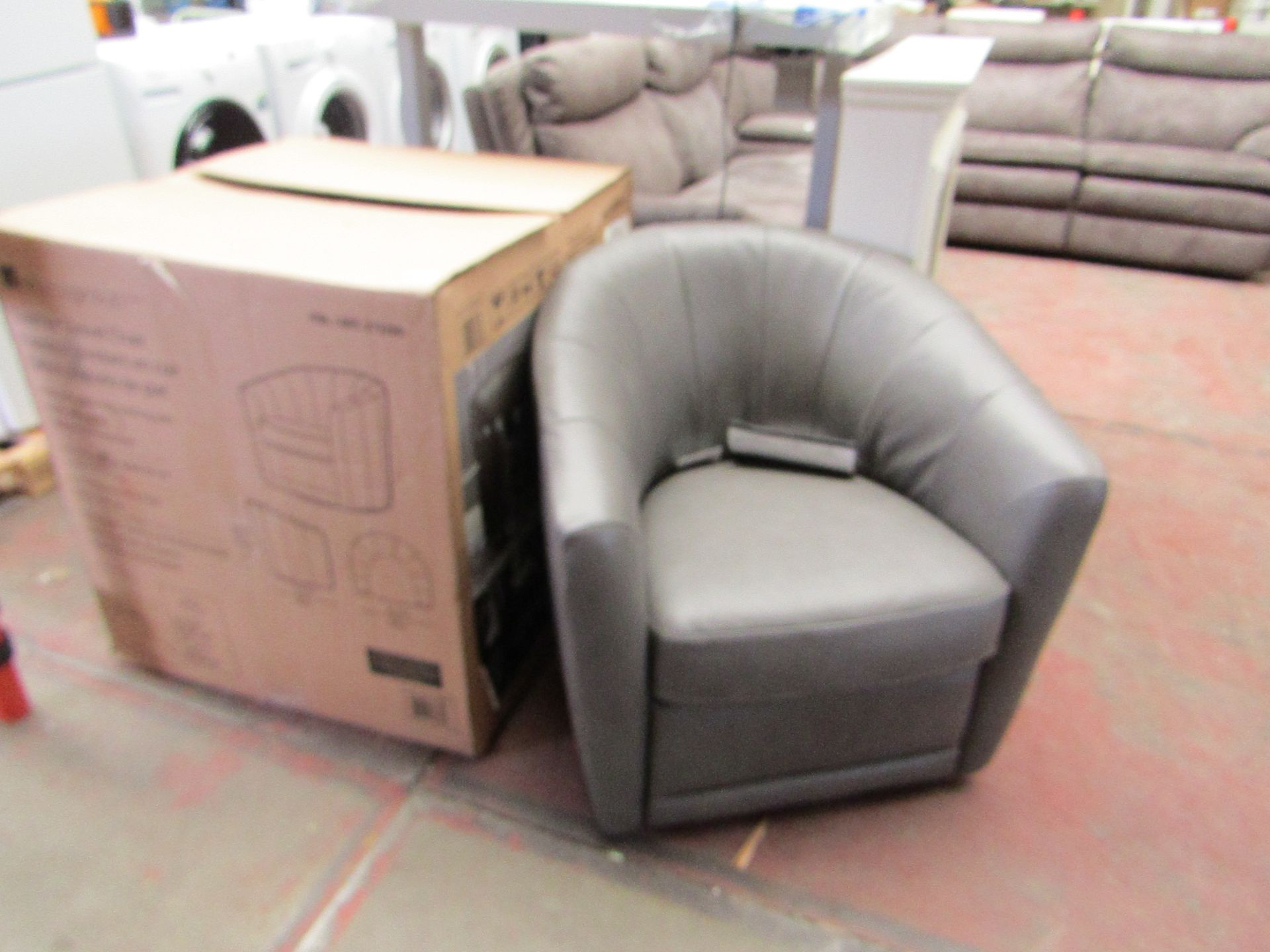Lot 29 - Natuzzi Grey leather swivel armchair, the Swivel mechanism needs attention but the chair is fine
