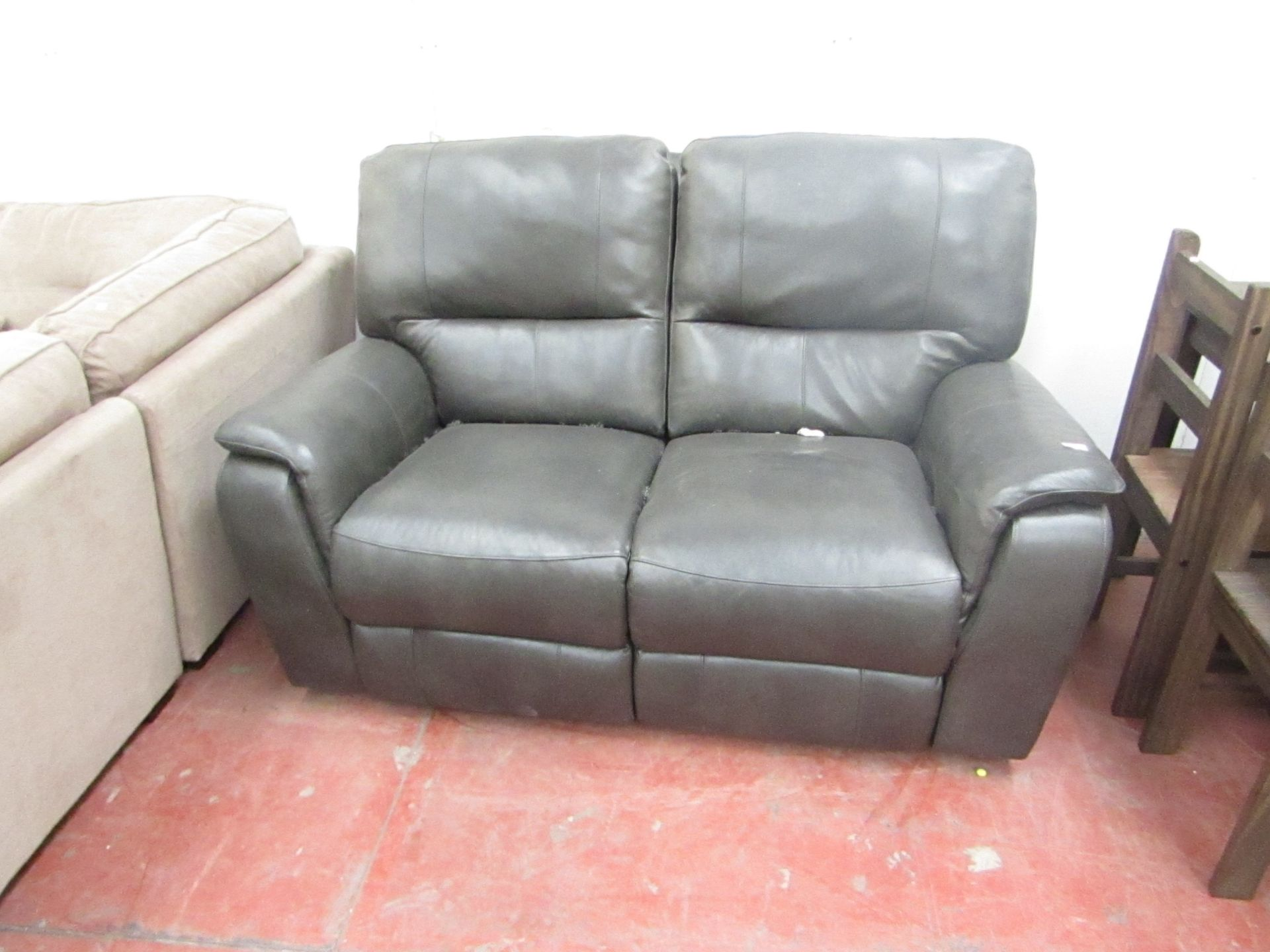 Lot 18 - Costco Itailian Leather Grey/Black 2 seater manual reclining sofa, the recline mechanism is in