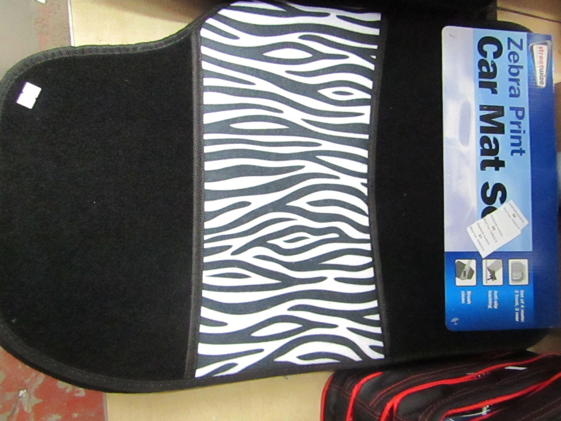 Lot 60 - Streetwise Zebra Print 4 piece car mat set, new with POS still attached