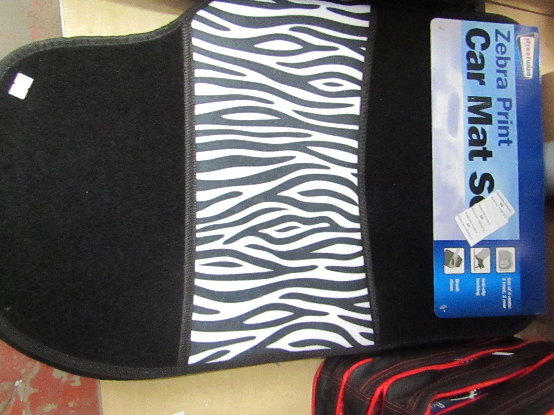 Lot 59 - Streetwise Zebra Print 4 piece car mat set, new with POS still attached