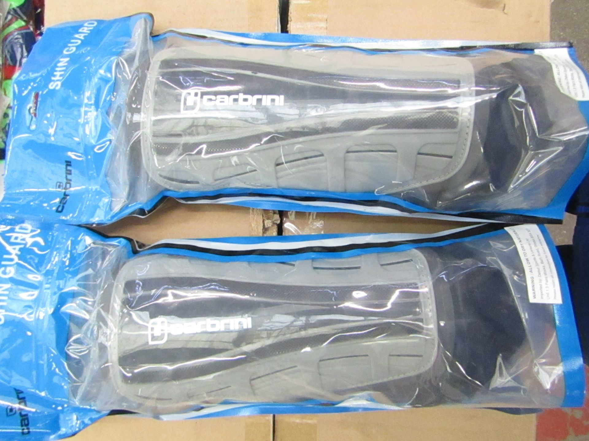 Lot 12 - 2 x Pair of Adult Carbrini Shin Guards with ankle protectors, new & packaged