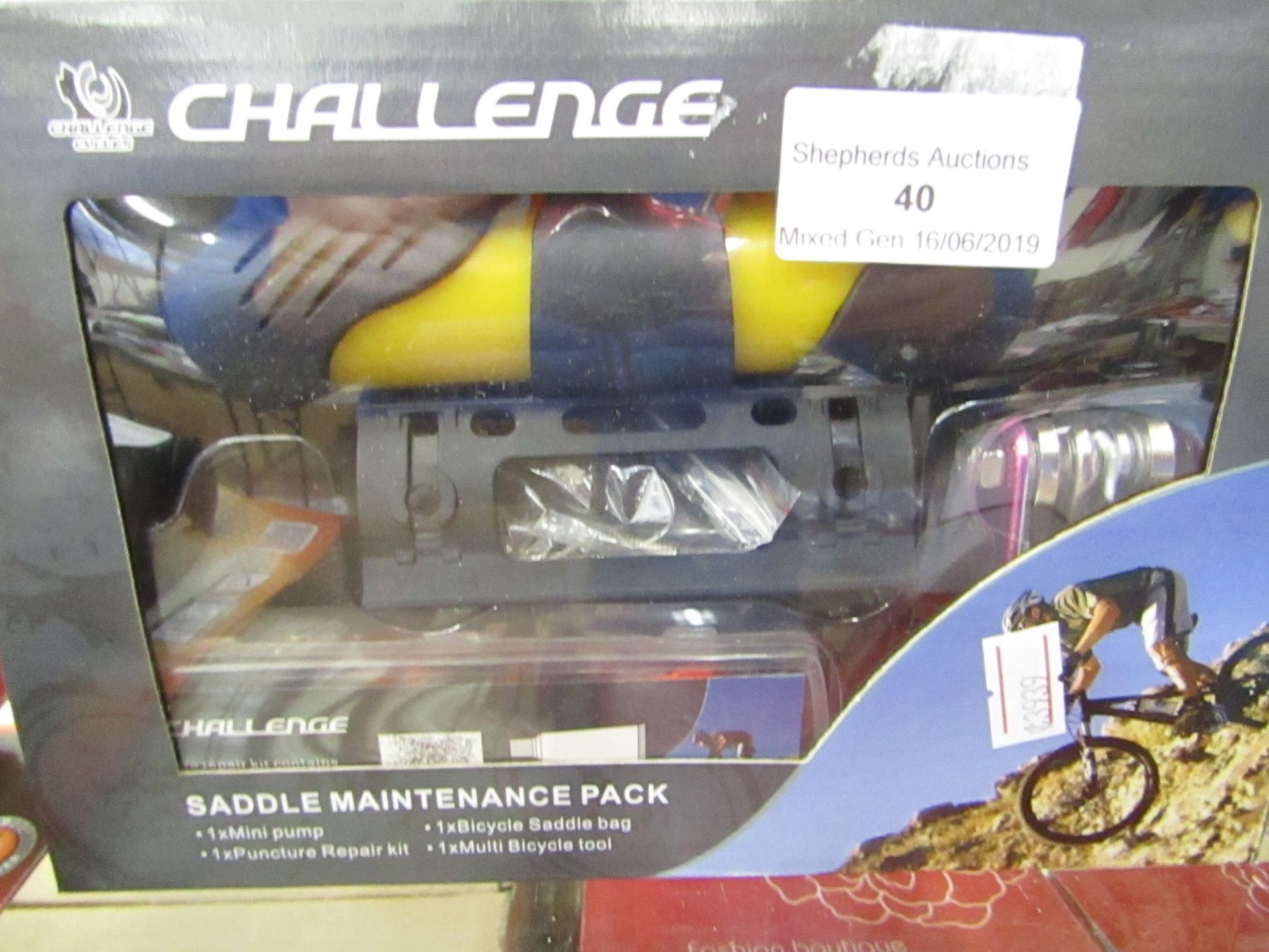 Lot 40 - Challenger Saddle Maintenance pack, includes a Pump, a Puncture repair kit, a Bicycle saddle bag