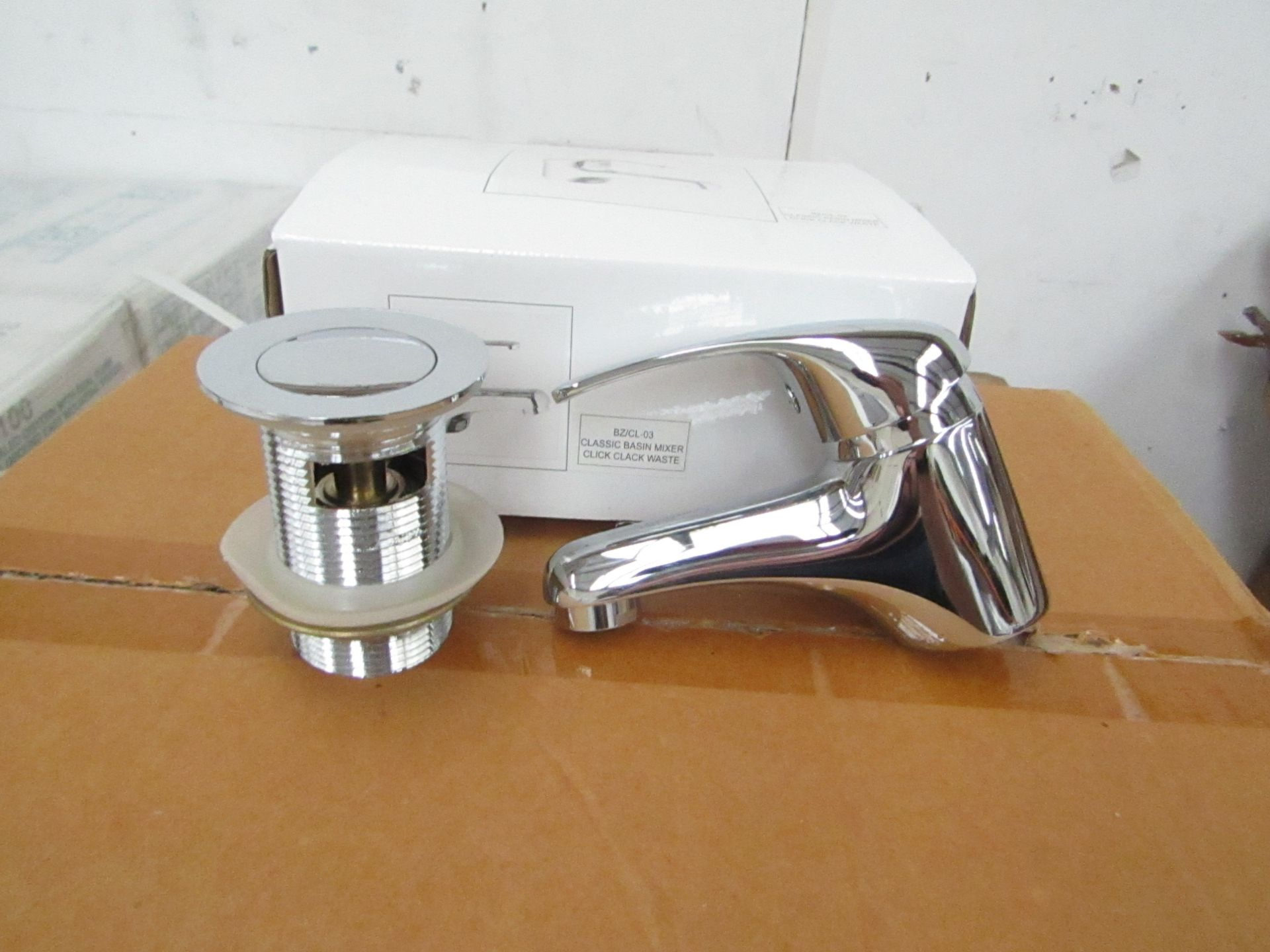 Classic Mono Block chrome plated Basin Mixer tap with chrome plated brass handle, includes click