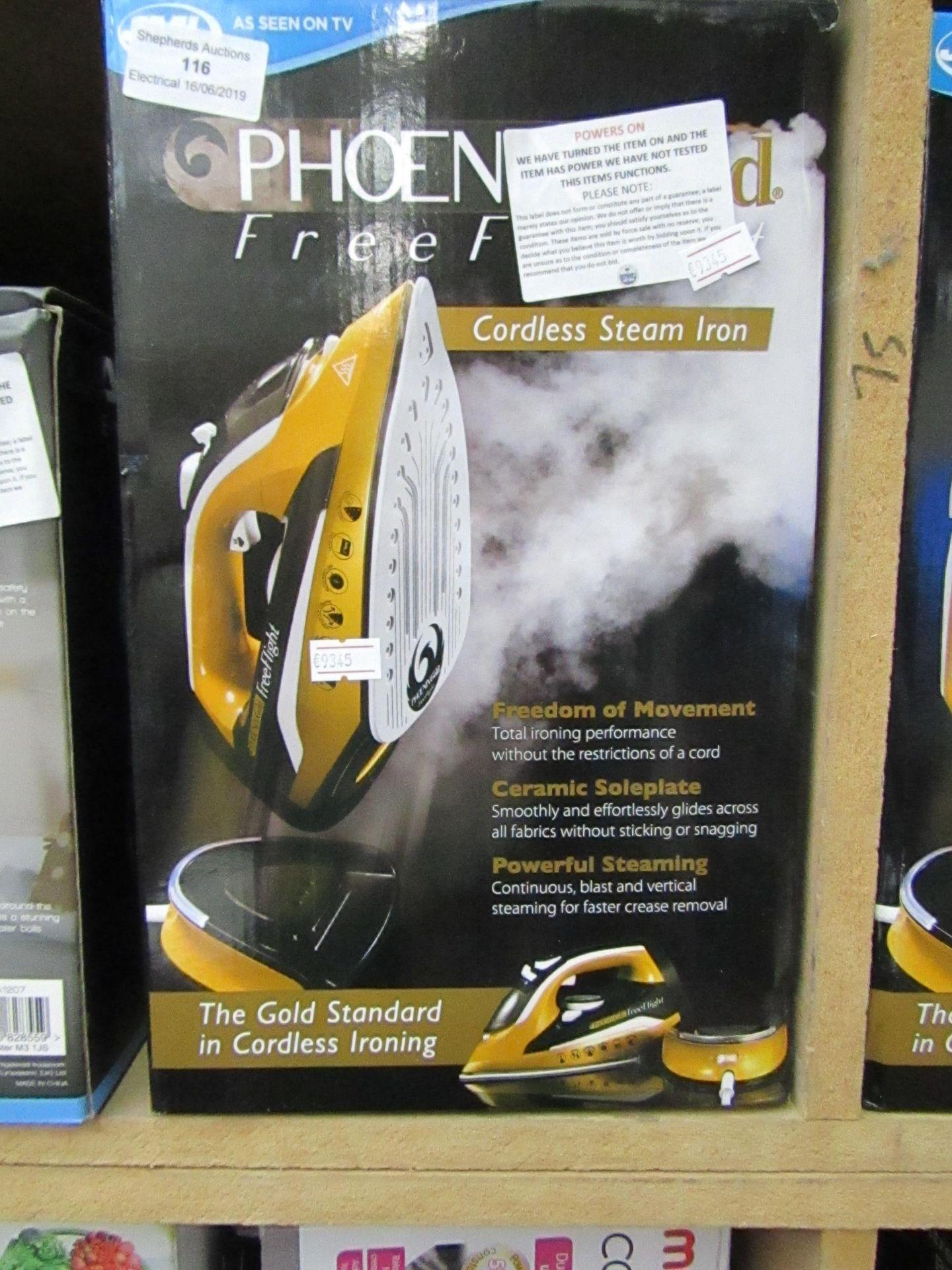 Lot 116 - JML Phoenix Gold Free Flight cordless steam iron, powers on and boxed.
