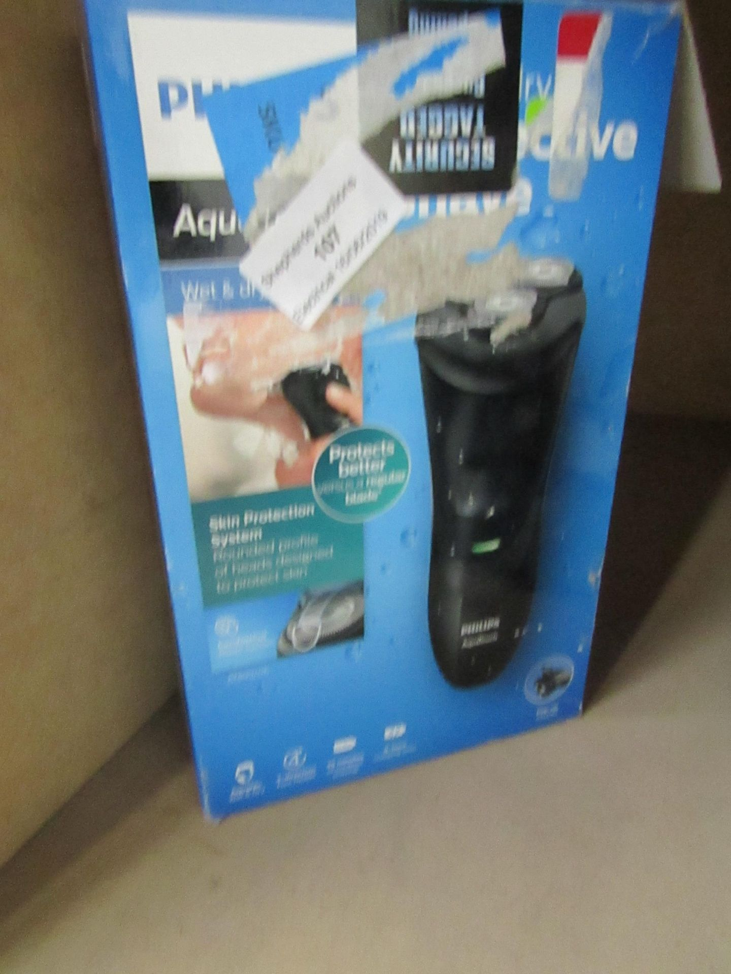 Lot 107 - Philips wet and dry beard trimmer, untested and boxed.