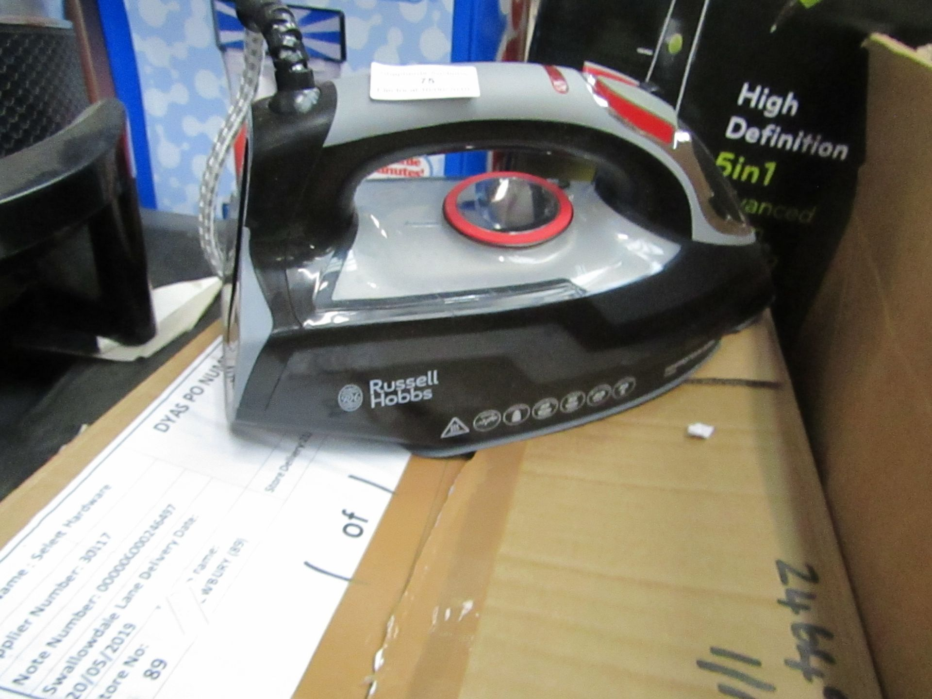 Lot 75 - Russell Hobbs steam iron, powers on.