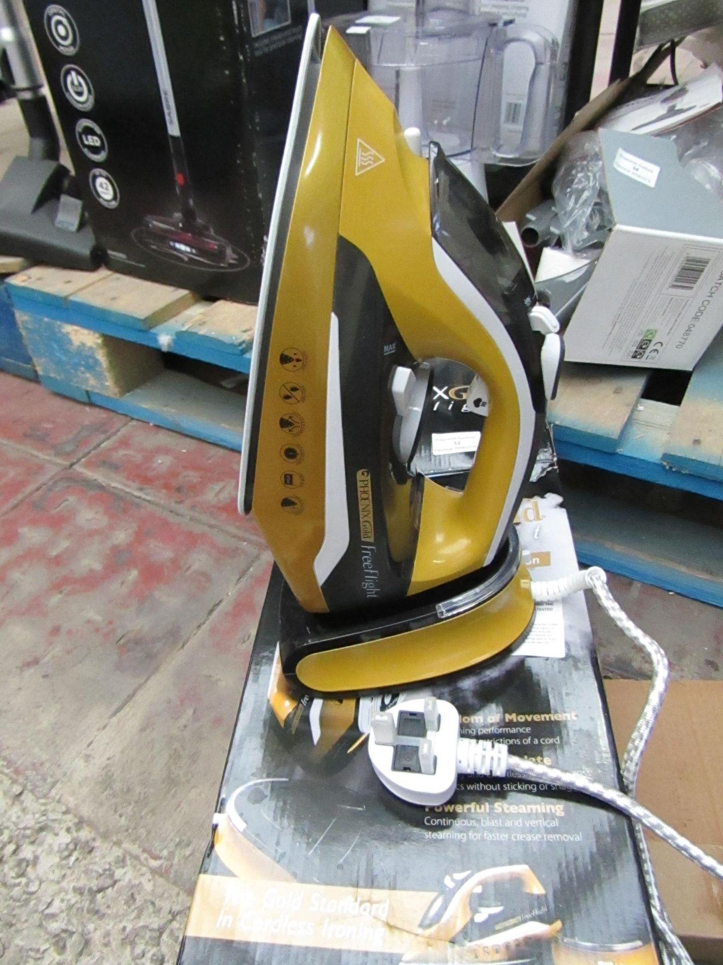 Lot 33 - JML Phoenix Gold Free Flight cordless steam iron, powers on and boxed.