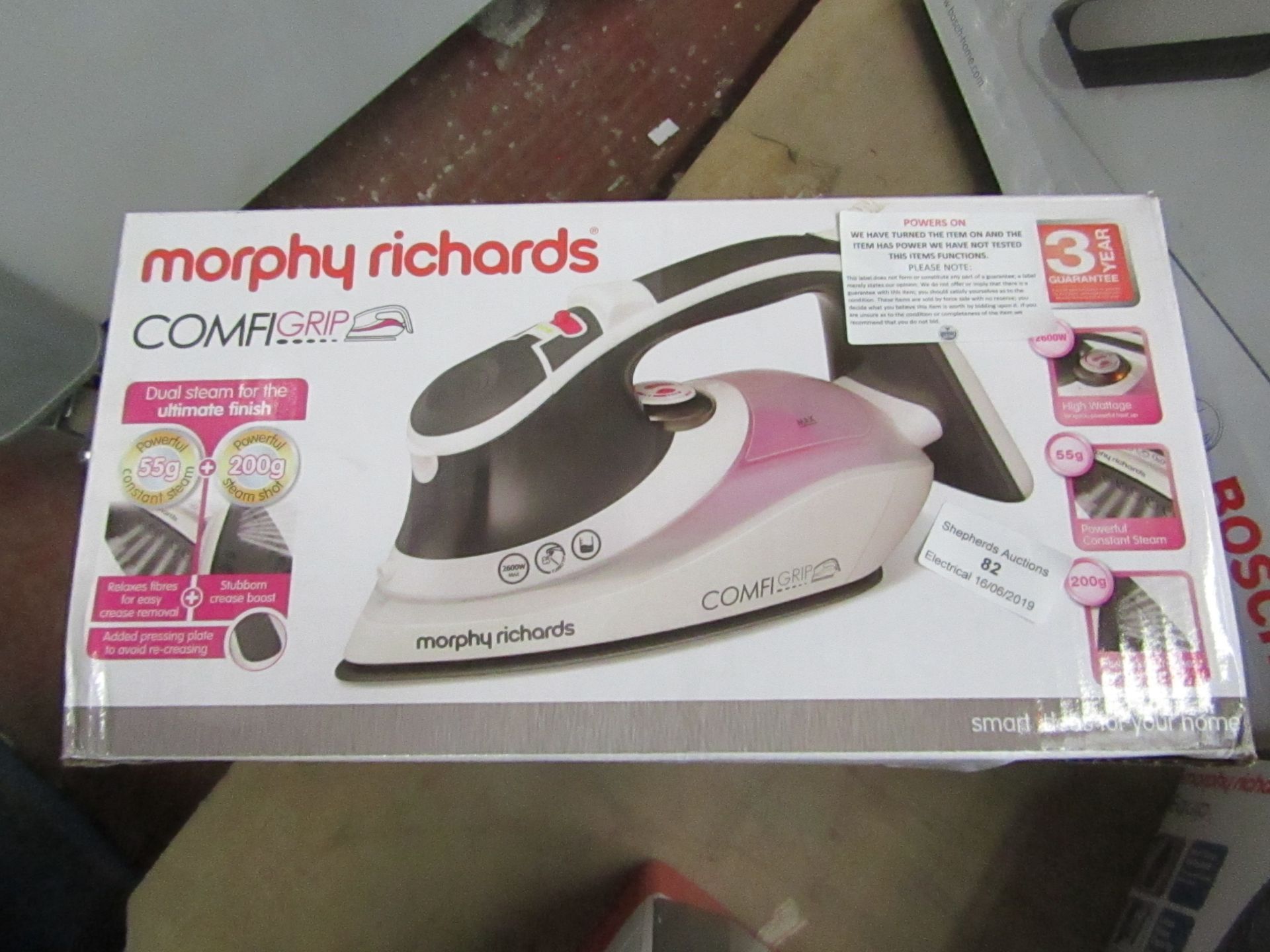 Lot 82 - Morphy Richards Comfi Grip steam iron, powers on and boxed.